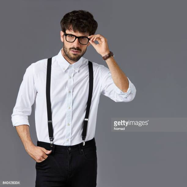 confident young businessman holding eyeglasses - suspenders stock pictures, royalty-free photos & images