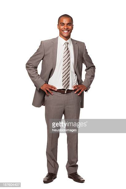confident young businessman. isolated. - black trousers stock pictures, royalty-free photos & images