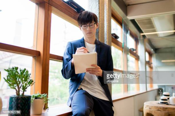 Confident young businessman making notes
