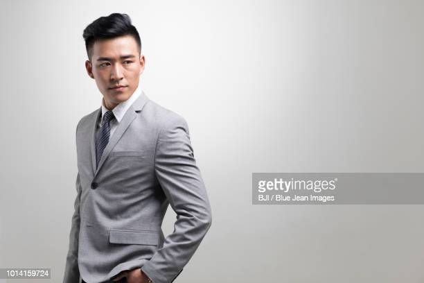 confident young businessman - hands in pockets stock pictures, royalty-free photos & images