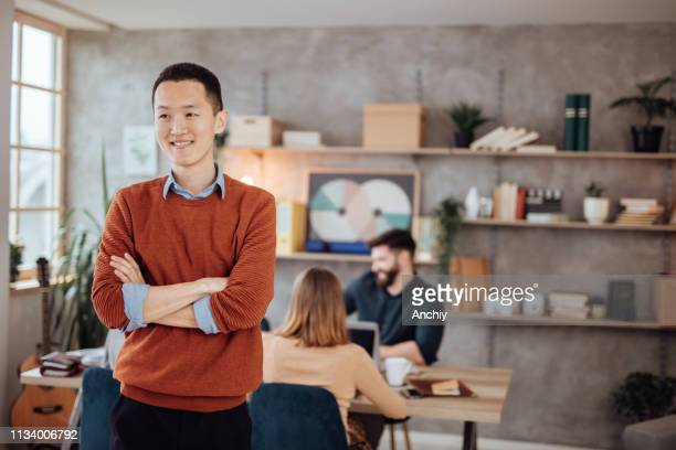 Confident young businessman posing in the office
