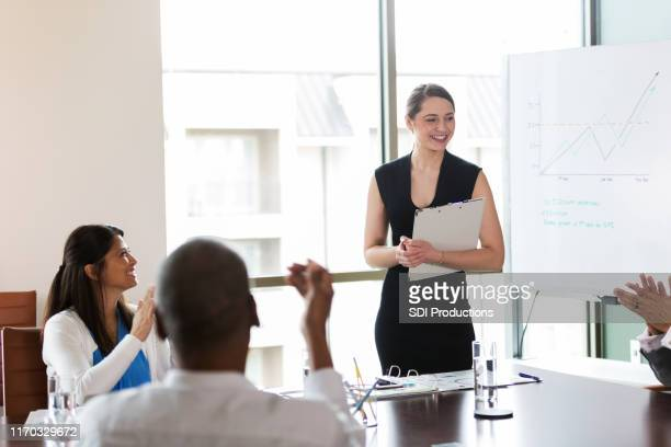 confident young businesswoman gives presentation - governing board stock pictures, royalty-free photos & images