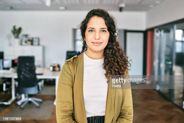 confident young businesswoman in creative office - waist up stock pictures, royalty-free photos & images