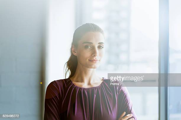 Confident young businesswoman in creative office
