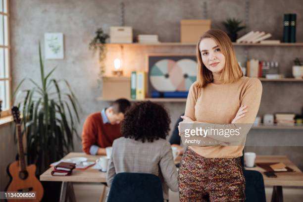 Confident young businesswoman posing in the office