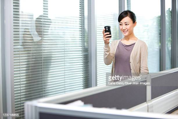 Confident Young Businesswoman Reading Text Message