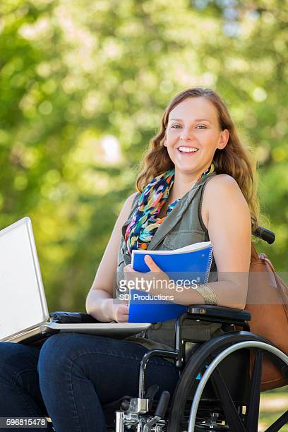 Confident young college student on campus in wheelchair