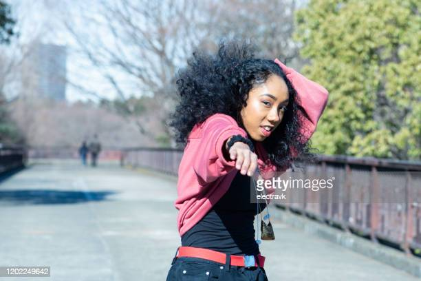 confident young dancer in the park - showus stock pictures, royalty-free photos & images