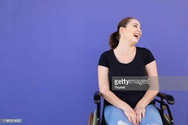 confident young disabled woman in wheelchair - physical disability stock pictures, royalty-free photos & images