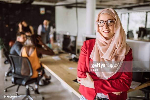confident young entrepreneur with hijab - creative director stock pictures, royalty-free photos & images