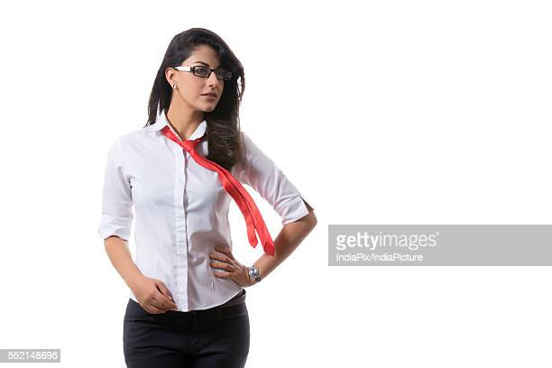 Confident young fashionable businesswoman over white background