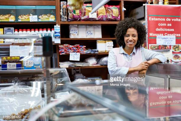 confident young female employee at store - pardo brazilian stock pictures, royalty-free photos & images