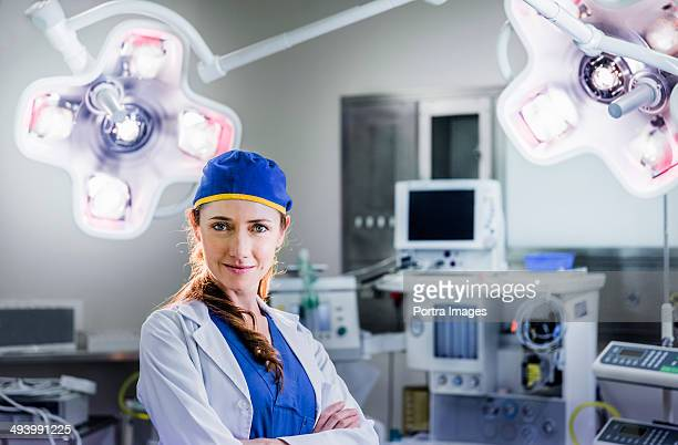 Confident young female surgeon in a hospital.