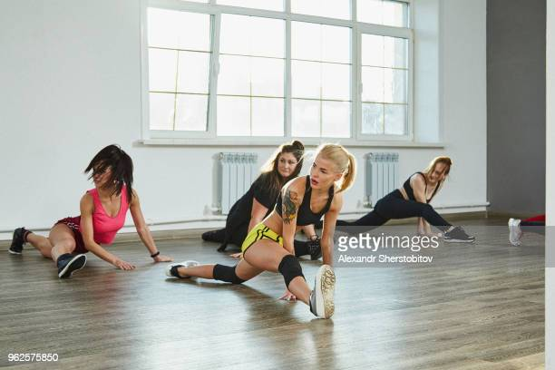confident young females practicing splits while dancing in studio - doing the splits stock pictures, royalty-free photos & images