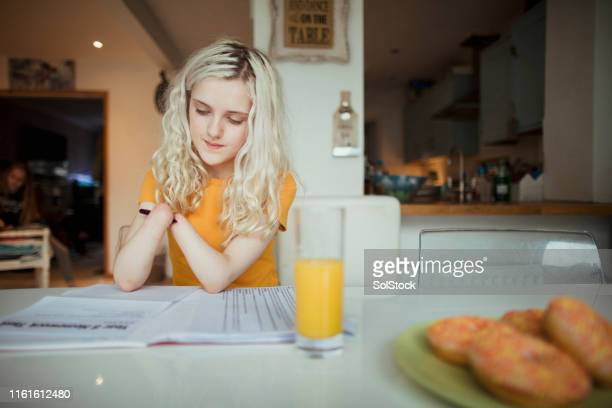 confident young girl does her homework - amputee girl stock pictures, royalty-free photos & images