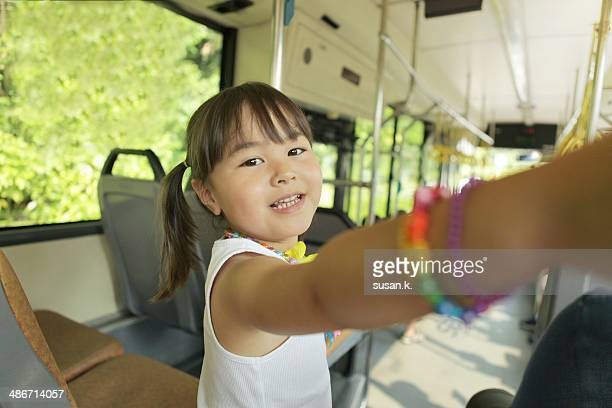 Confident young girl rides on public bus herself