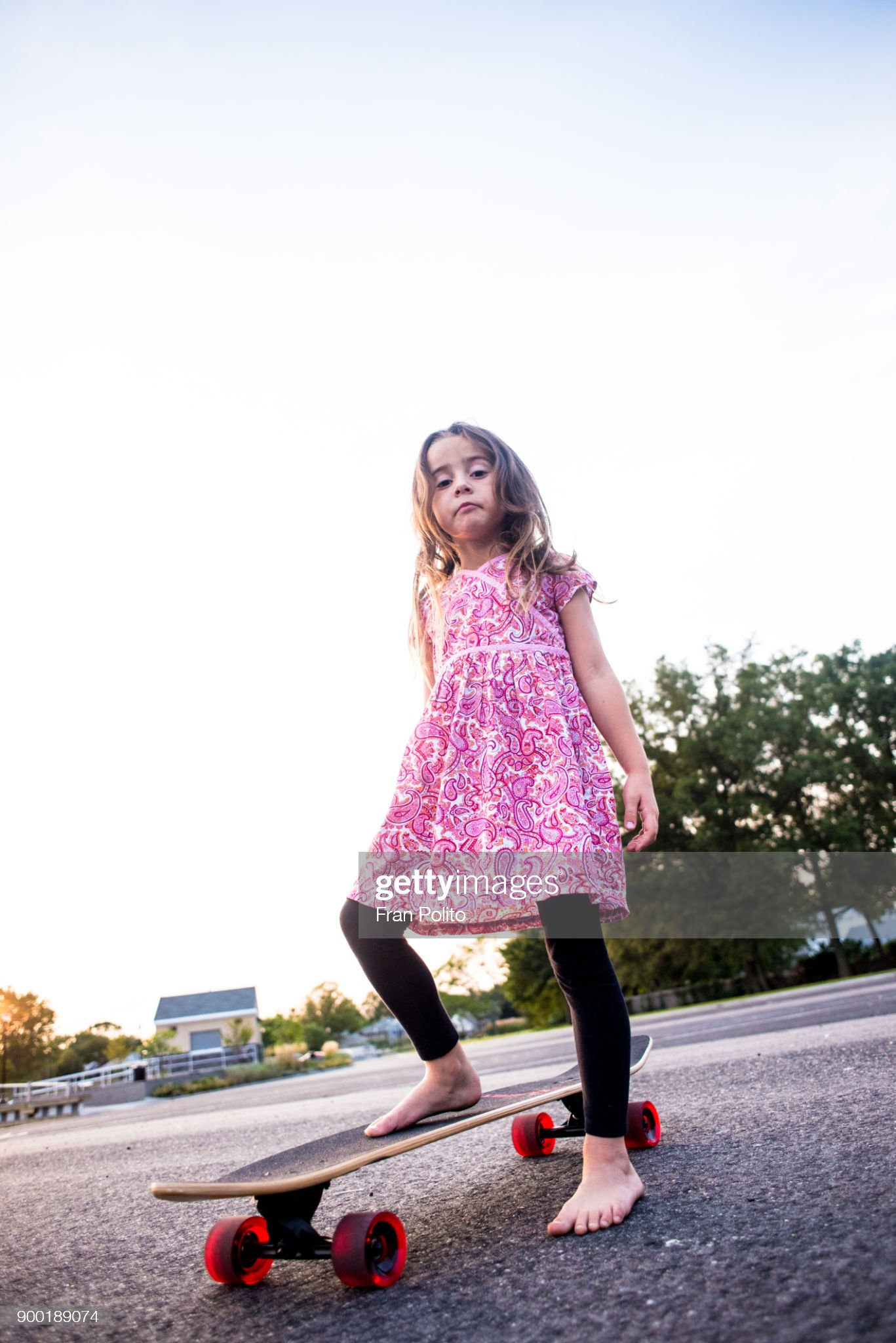 https://media.gettyimages.com/photos/confident-young-girl-standing-on-her-skateboard-picture-id900189074?s=2048x2048