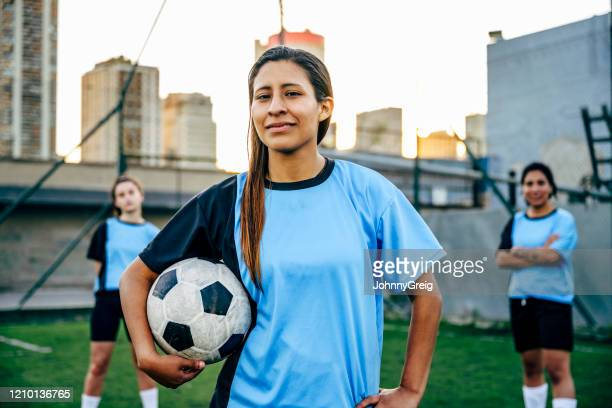 confident young hispanic footballer identifying as male - gender fluid stock pictures, royalty-free photos & images