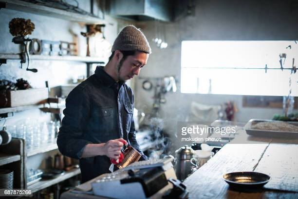 confident young male happy cafe owner - 経済 stock pictures, royalty-free photos & images