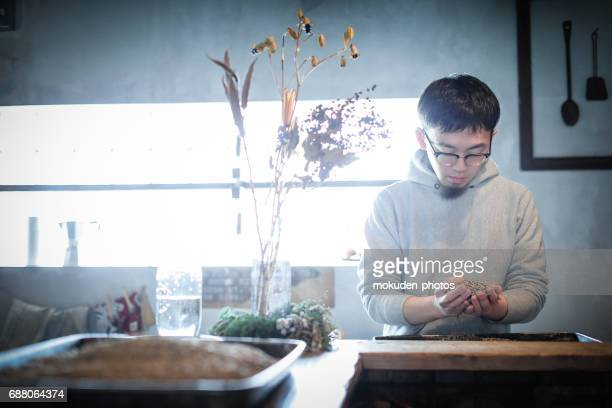 confident young male happy cafe owner - ミッドアダルト stock pictures, royalty-free photos & images