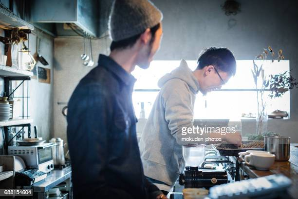 confident young males happy cafe owner - 経済 stock pictures, royalty-free photos & images