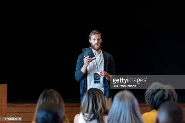 confident young man address people during seminar - launch event stock pictures, royalty-free photos & images