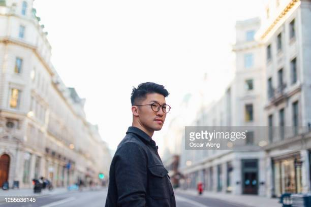 confident young man discovery the city - confidence stock pictures, royalty-free photos & images