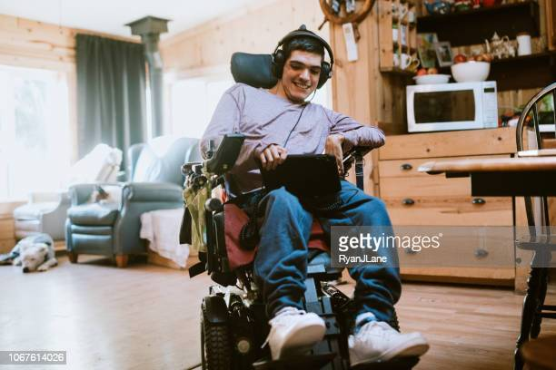 Confident Young Man In Wheelchair At Home