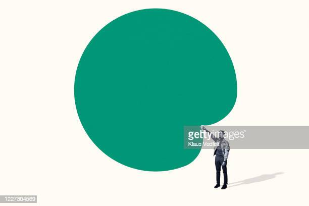 confident young man poking large green blob - gesturing stock pictures, royalty-free photos & images