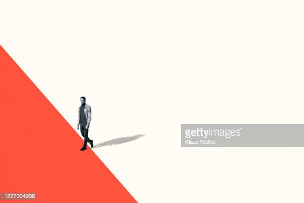 confident young man walking while looking away - white background stock pictures, royalty-free photos & images