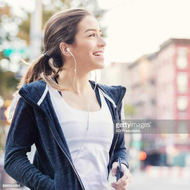 Confident young waits for ride in the city