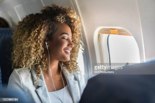 Confident young woman enjoys flight