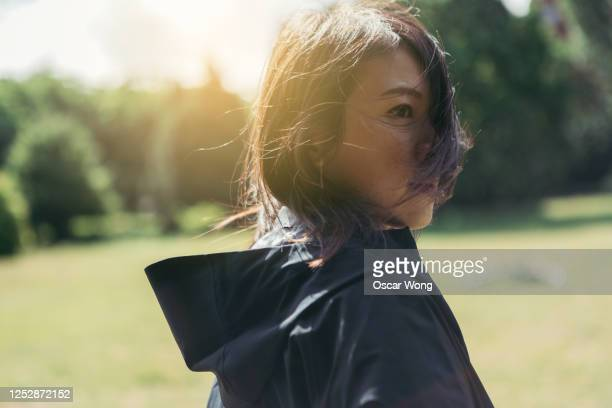 confident young woman planning her future - walking stock pictures, royalty-free photos & images