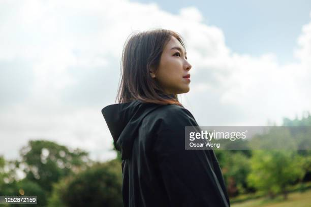 confident young woman planning her future - standing stock pictures, royalty-free photos & images