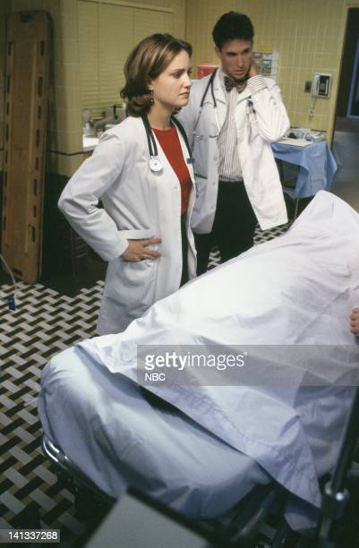 ER ER Confidential Episode 9 Air Date Pictured Sherry Stringfield as Doctor Susan Lewis Noah Wyle as Doctor John Carter Photo by Alice S Hall/NBCU...