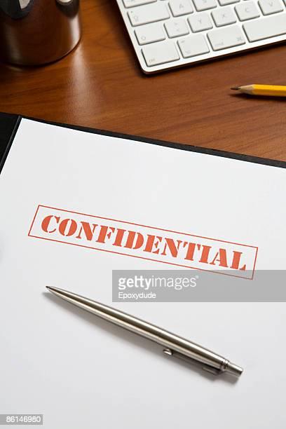 A confidential file on a desk