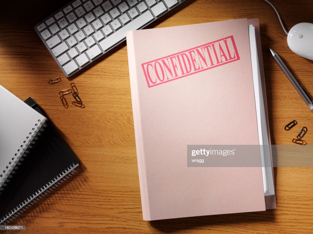 Confidential Folder on a Desk : Stock Photo