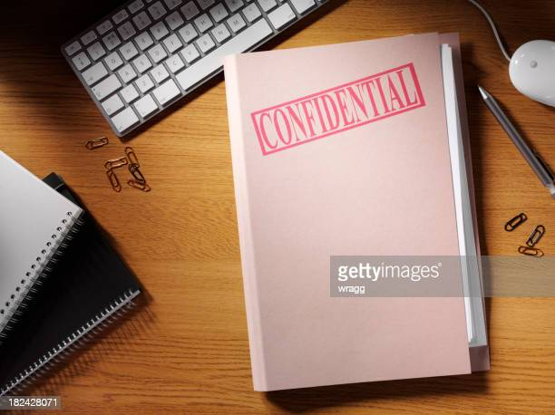 confidential folder on a desk - private stock pictures, royalty-free photos & images