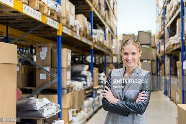 Confidential woman smiling in warehouse