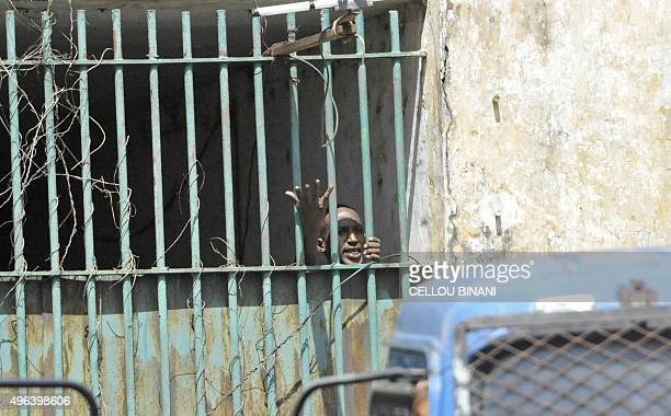 A confined prisoner gestures during an attempted prison escape on November 9 2015 in Conakry A mutiny broke out on November 9 in the civil prison of...