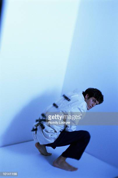 confioned man wearing strait jacket (blue tone) - straight jacket stock pictures, royalty-free photos & images
