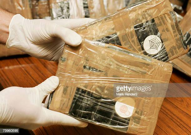 Confiscated bags containing cocaine are displayed at the Brussels Federal Police station on April 24 2007 in the Belgian capital Brussels 350 kg of...
