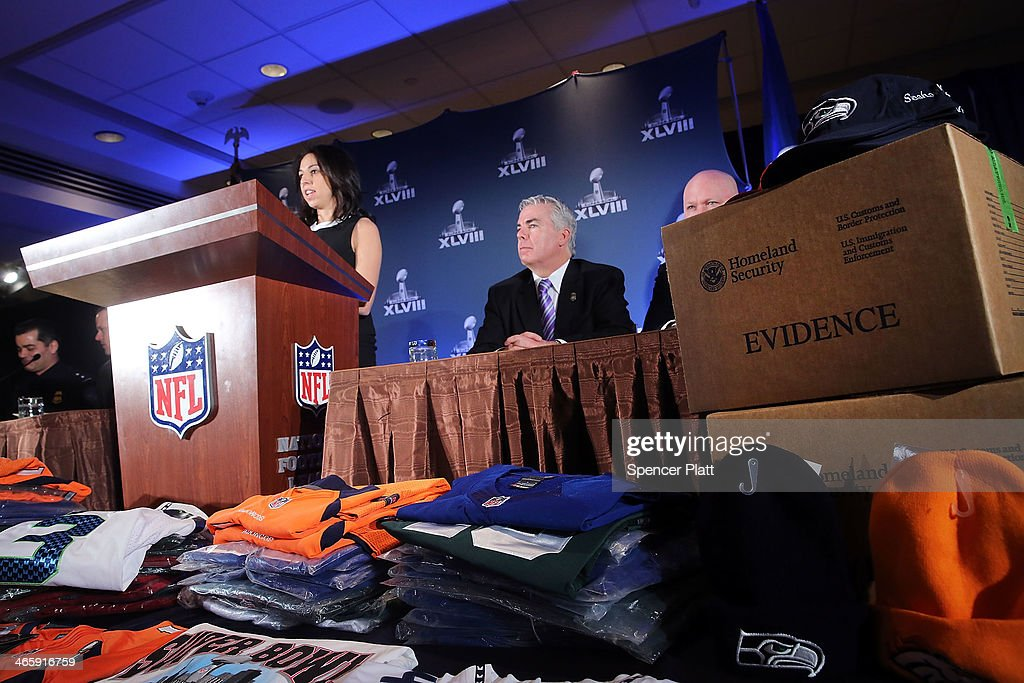 Confiscated counterfeit Super Bowl XLVIII merchandise is viewed at a news conference on the latest seizure of the merchandise leading up to the Super Bowl on January 30, 2014 in New York City. Officials from the National Football League, U.S. Immigration and Customs Enforcement and U.S. Customs and Border Protection displayed recently confiscated items while also showing phony websites that have been set-up to sell Super Bowl XLVIII merchandise. Counterfeit sports merchandise, much of which originates in China, is a multi million dollar industry.