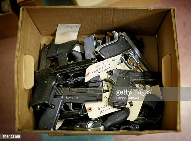 Confiscated guns sit in a box at the Sheriff's crime lab in San Diego CA on Tuesday March 19 2013 The weapons will eventually be melted down to scrap