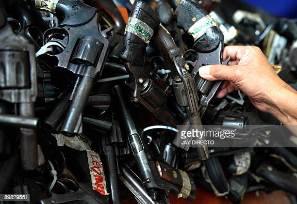 Confiscated loose firearms are presented to the media during a press briefing at the headquarters of the Philippine National Police in Quezon City...