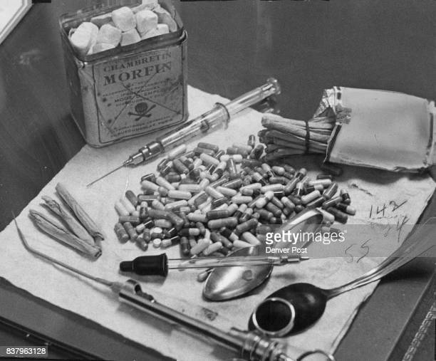 DEC 26 1957 DEC 29 1957 JUN 9 1970 'JUNK' PEDDLERS' STOCK IN TRADE Confiscated narcotics and implements used by addicts are shown at Morals Bureau...