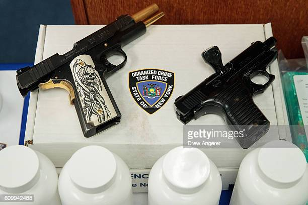 Confiscated weapons are displayed before a press conference regarding a major drug bust at the office of the New York Attorney General September 23...