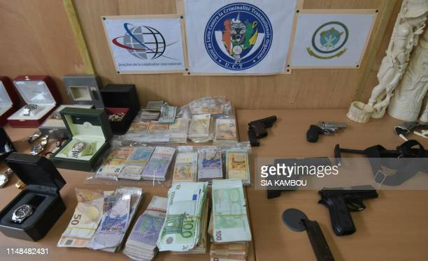 Confiscated weapons, banknotes and ivory items are displayed to the press after a network of drug trafficking was dismantled, on June 7 at the...