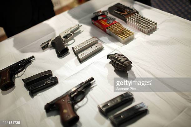 Confiscated weapons lay on a table during a news conference about the breakup of a suspected terror plot against New York synagogues on May 12 2011...