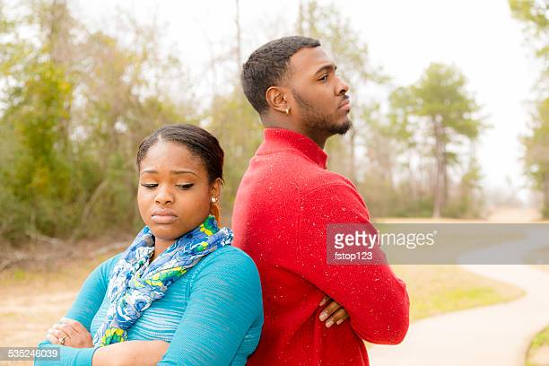 Conflict, arguement between African descent couple. Sadness, despair, anger.